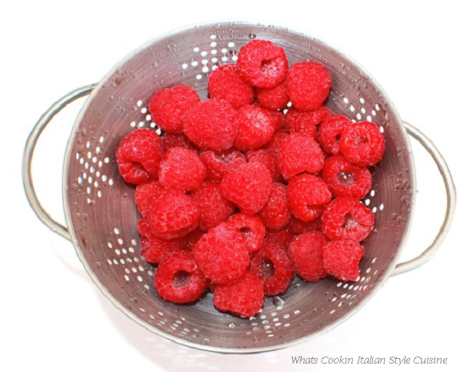 this is red fresh raspberry in a colander