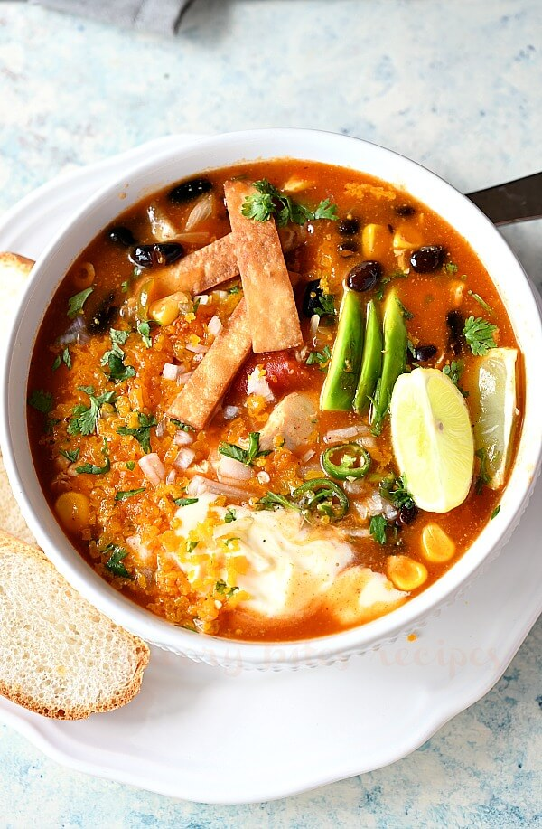 tortilla strips,sour cream and cheddar on top of chilis enchilada soup recipe