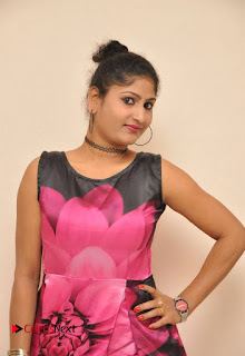 Actress Asmitha Khan Pictures in Floral Frock at Dirty Game Audio Launch 0010