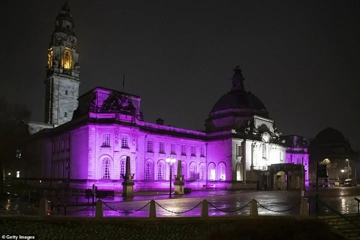 British landmarks are lit in purple due to the Holocaust. Pictures