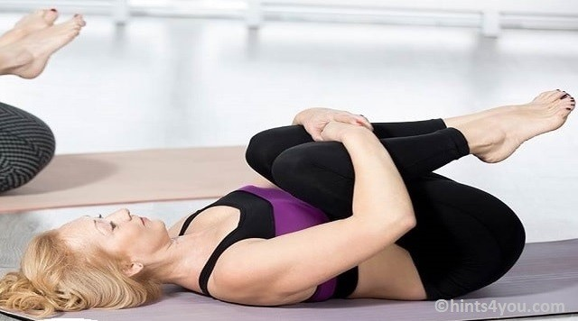 Now hold legs with both hands and move the neck towards the knees.