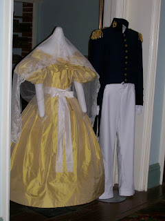 Reproductions of Robert and Mary Lee's portrait clothing.
