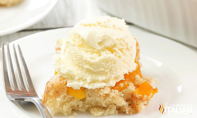 dump cake with peaches cut with ice cream on top