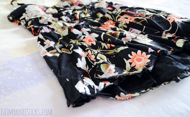 Details on the two-piece boho-chic matching floral lace-up cropped bralette top and flowy high-waisted shorts set from SheIn.