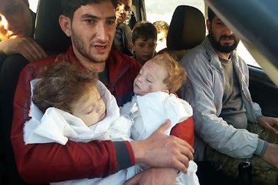Heartbreaking Moment Grieving Dad Cradles Twin Babies Killed In Gas Attack