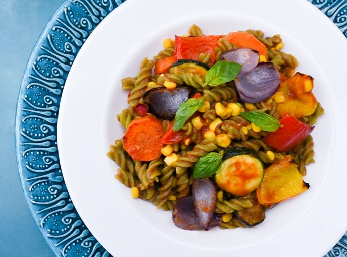 A bowl of spiral pasta with roast vegetables