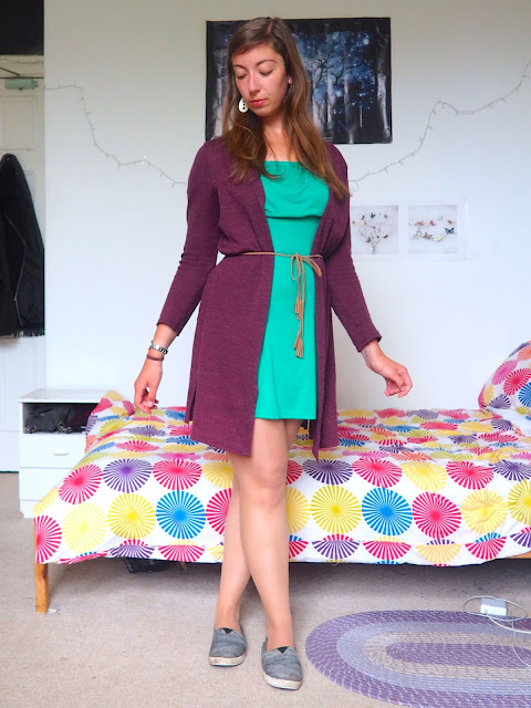 Picnic Weather - outfit of green dress & purple cardigan belted at waist, with grey Toms