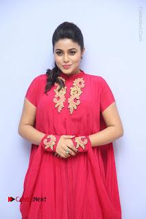Actress Poorna Latest Stills in Red Dress at Rakshasi First Look Launch  0112.JPG