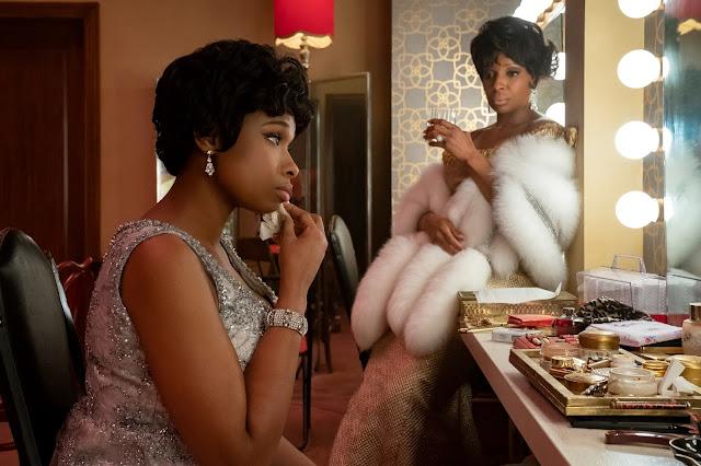 Two Black women talk in a dressing room
