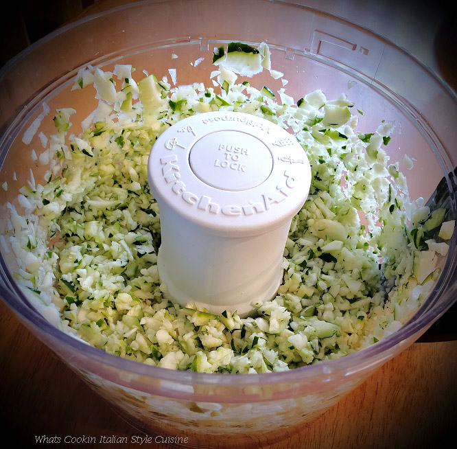 this is grated zucchini in a food processor