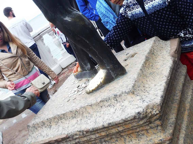 The shiny feet of the statue of Neptune at Peterhof, St. Petersburg
