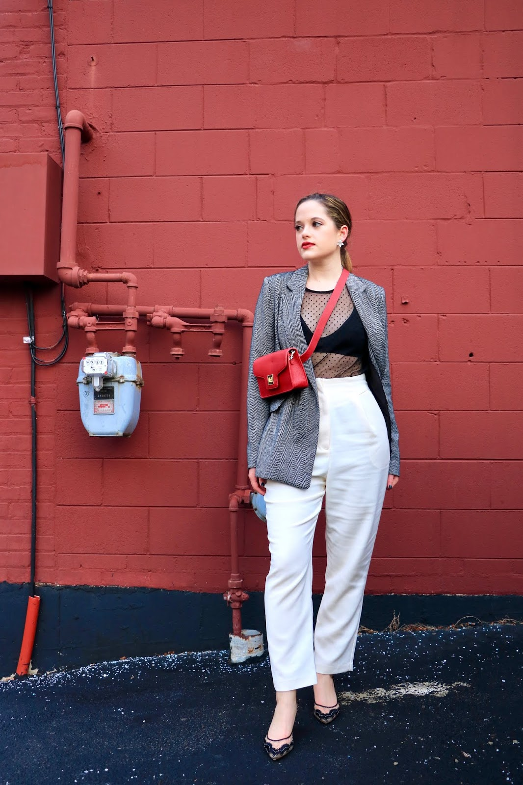 Nyc fashion blogger Kathleen Harper wearing a date night outfit with pants.