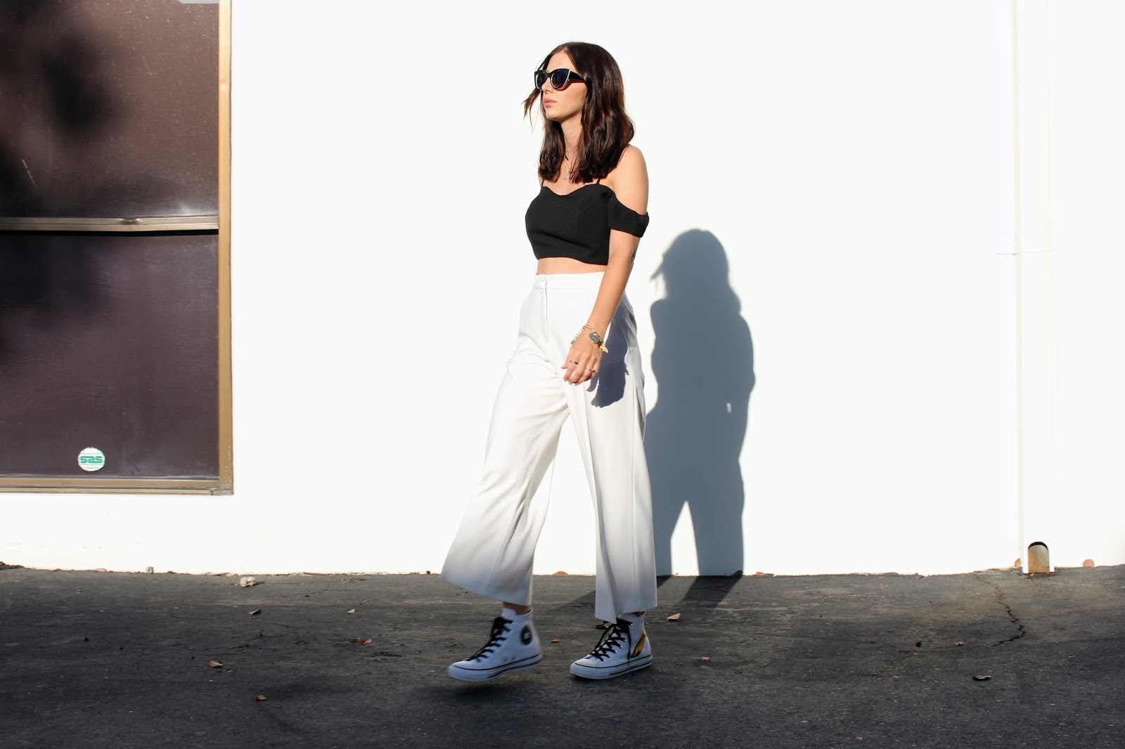 white white pants, off shoudler-top, converse