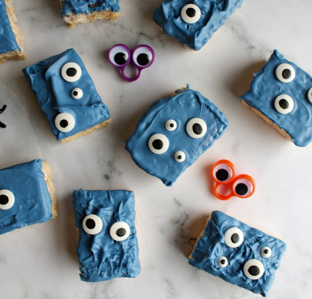 rice krispie treat topped with blue chocolate and lots of eyeball candies