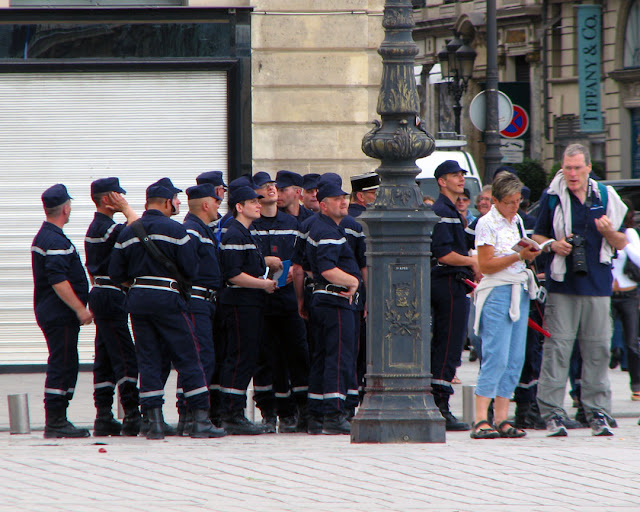 Tourist and police officers in place Vendôme, Paris