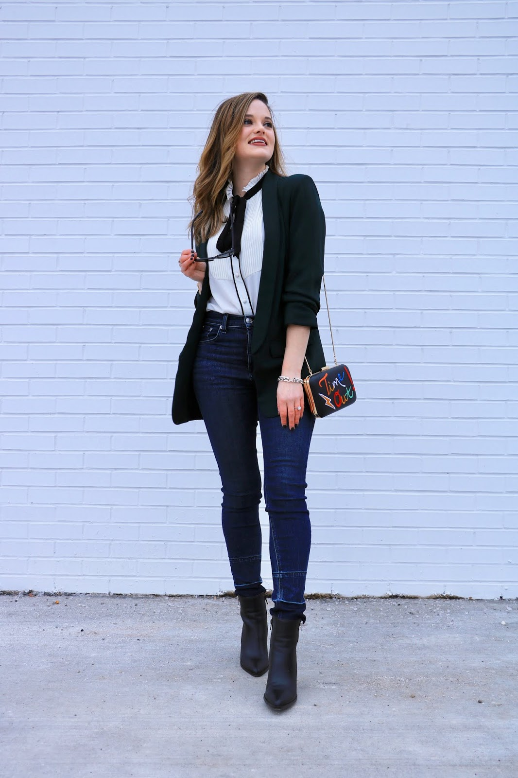 Nyc fashion blogger Kathleen Harper showing how to wear skinny jeans to work.