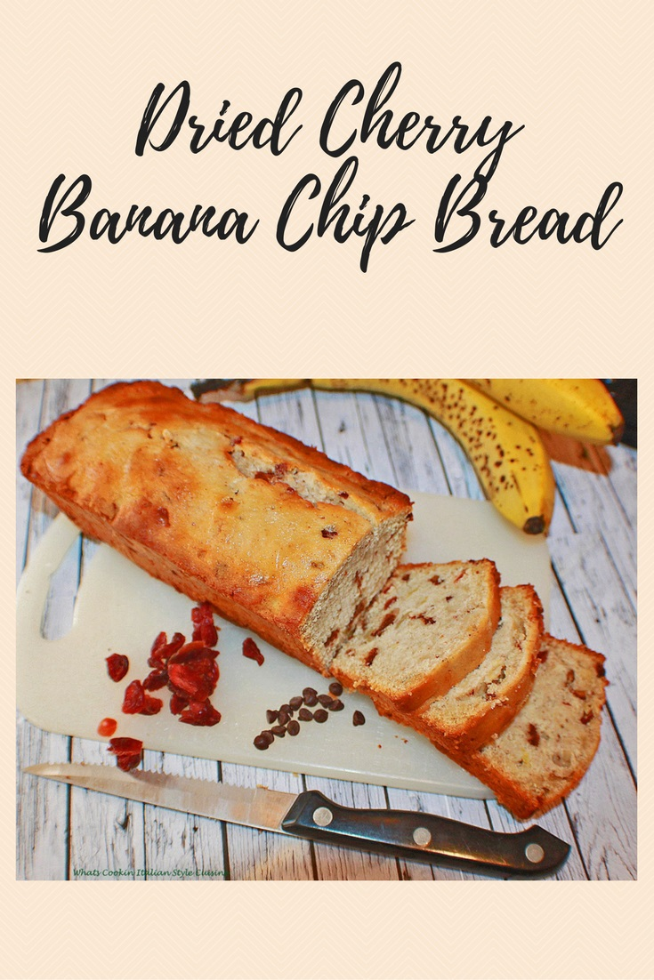 Banana bread with dried cherries and chocolate chips taste like a chocolate  covered cherry banana bread easy and simple to make banana bread on a cutting board ready to slice up and eat