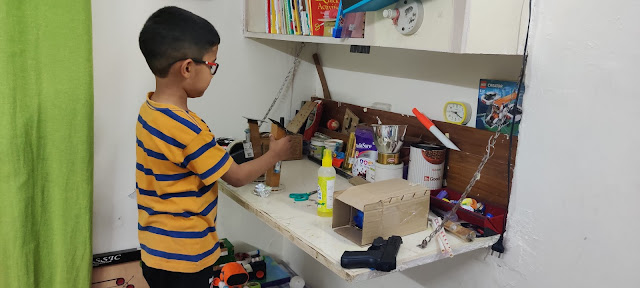 Boy making science toys in his homeschool
