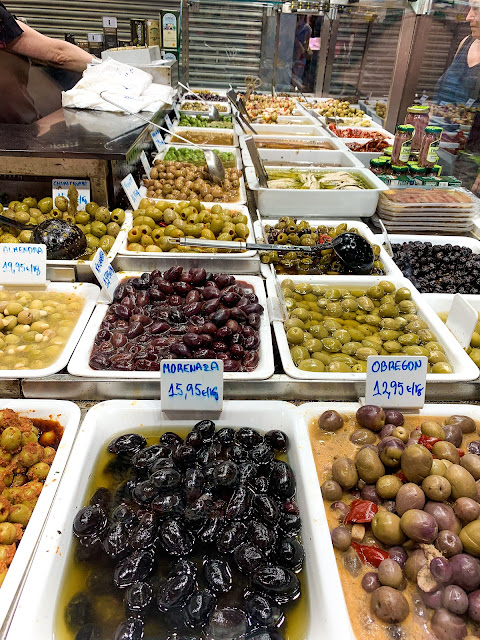 Lots of different kind of olives in a wee basket - black, green