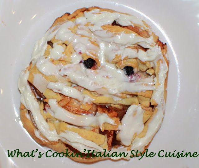 this is pie dough transformed into a mummy apple galette. This shows how to make a mummy using pie crust and its filled with apple pie filling. The eyes are made with blueberries and  a Halloween treat.