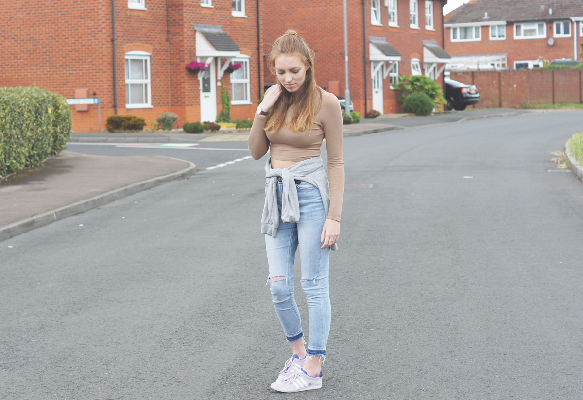 long sleeved camel crop top with ripped jeans