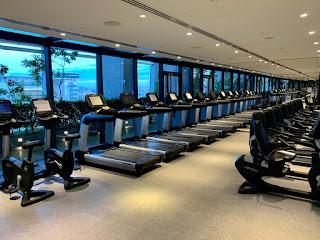 Row of treadmills with city views, JW Marriott Singapore Beach Road, 2021
