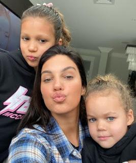 Ellie Penfold clicking selfie with her kids