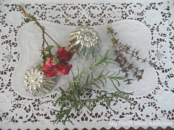 Tart Tin and Herb Flower Garden Mantel mythriftstoreaddiction.blogspot.com Repurposed flowers created from tart tins paired with herbs for a natural spring mantel