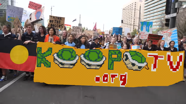 Global climate change strike protestors KoopaTV protect sign