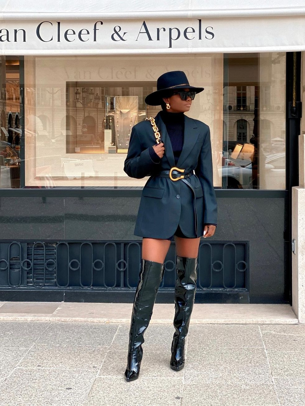 Black blazers and thigh high boots
