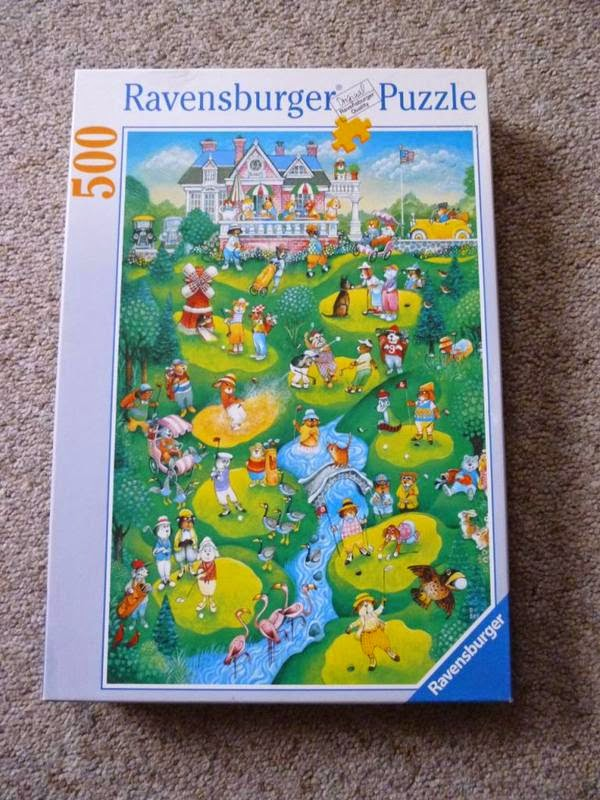A Ravensburger jigsaw puzzle that includes a crazy golf windmill on the golf course