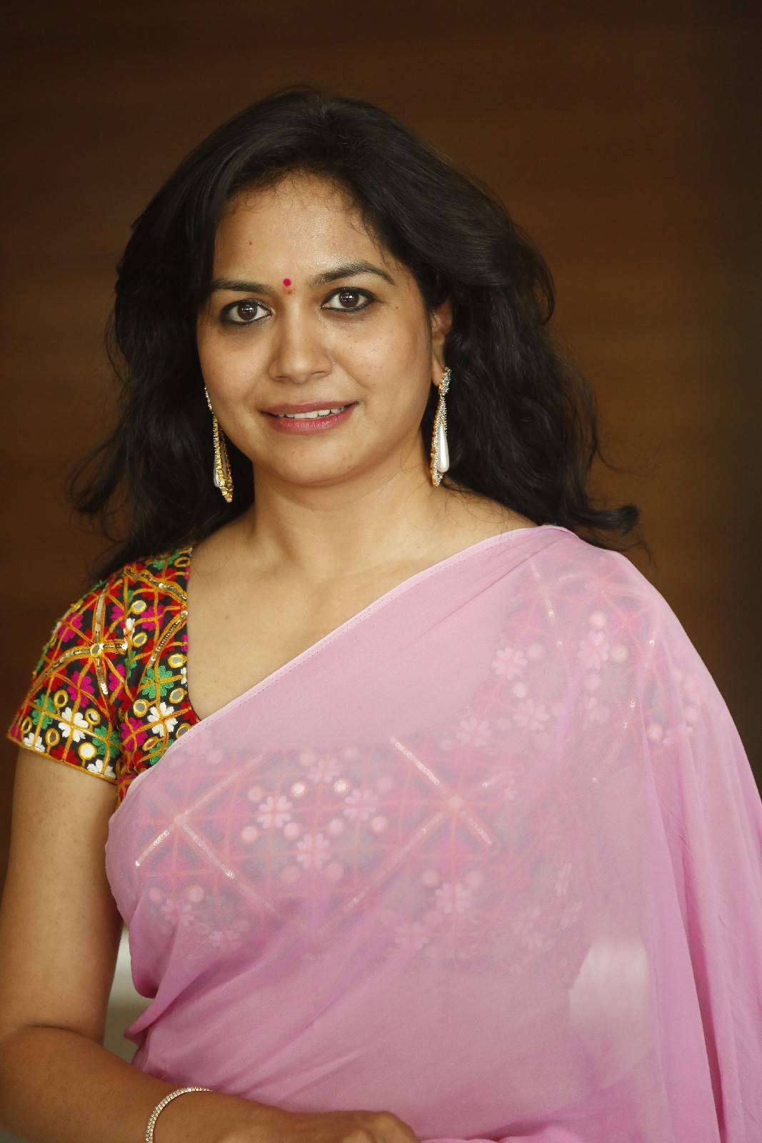 Singer Sunitha Latest Stills In Pink Saree