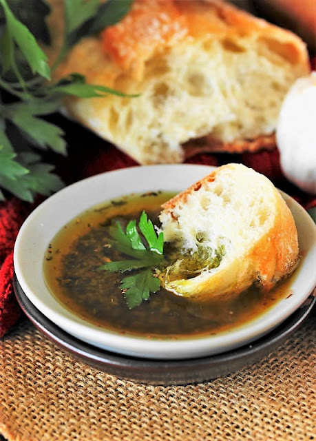 Dish of Simple Olive Oil Bread Dip with Bread Image