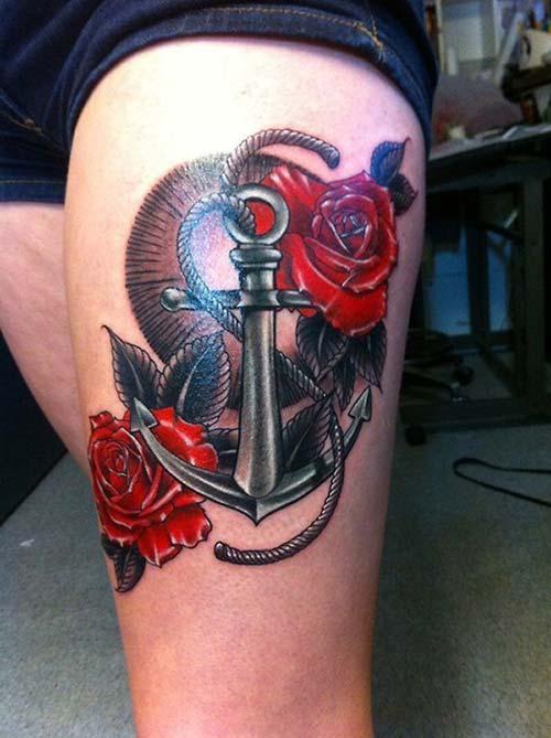 kadın üst bacak gül ve çapa dövmesi woman thigh anchor and rose tattoo