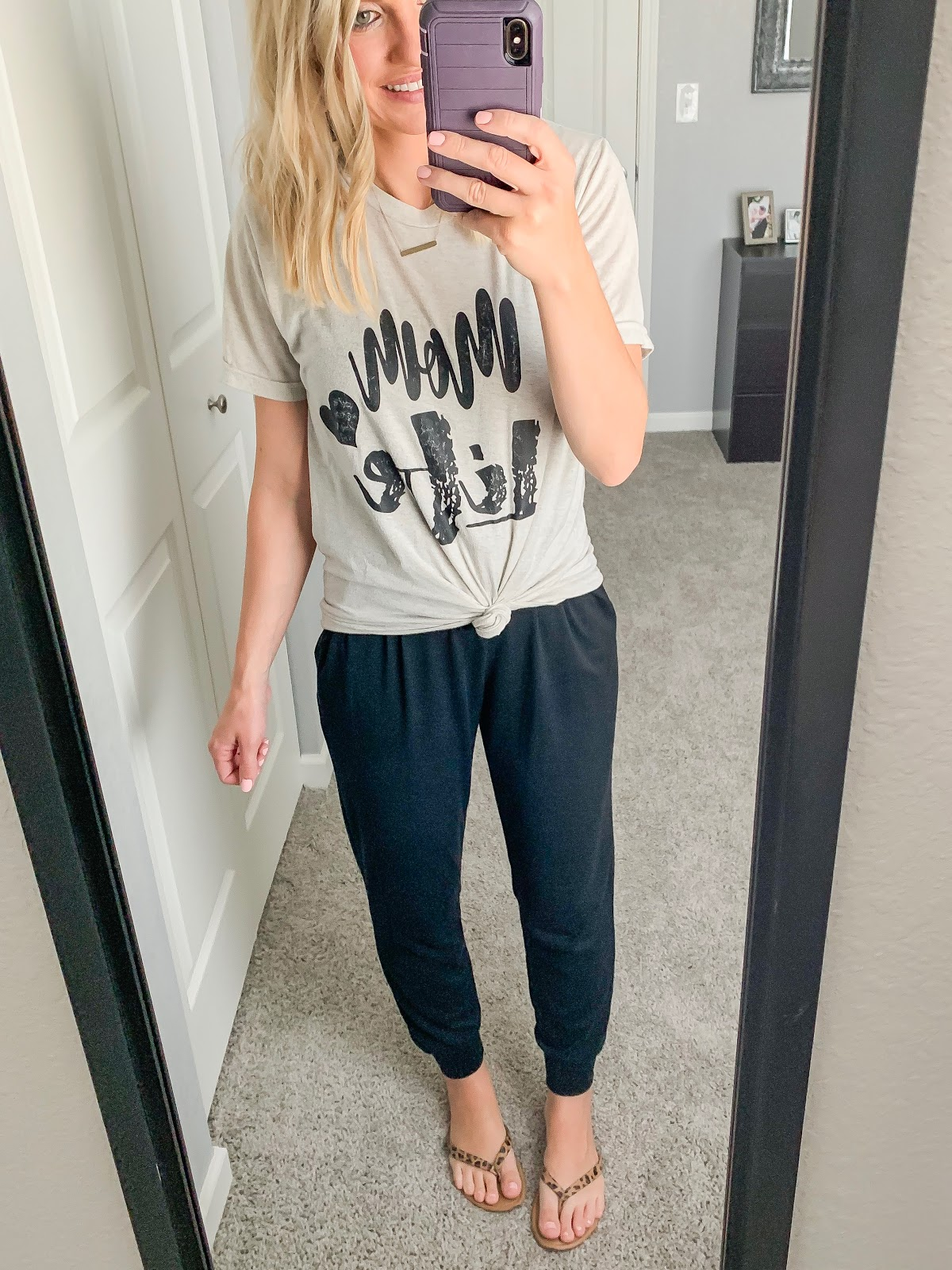 Black jumpsuit styled with a graphic t-shirt