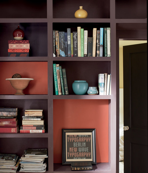 bookcase with books and decor and back wall painted with Benjamim Moore Rosy Peach