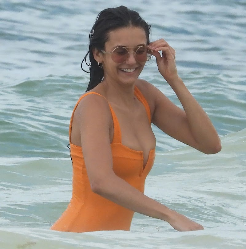 Nina Dobrev Clicked  in orange Swimsuit at a Beach in Tulum 21 Aug -2020