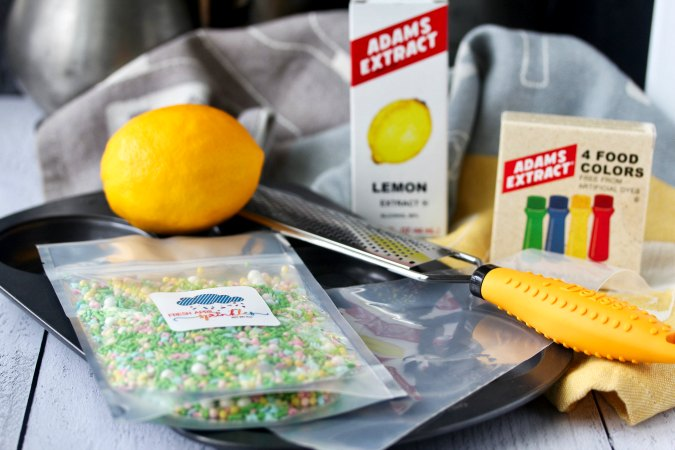 Tools and ingredients for making lemon doughnuts