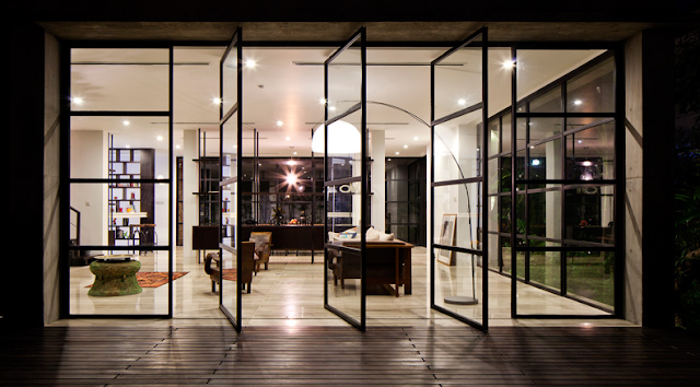 The pivoting set of glass doors provides a seamless transition between the inside and outside