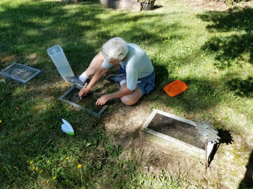 cleaning a grave marker