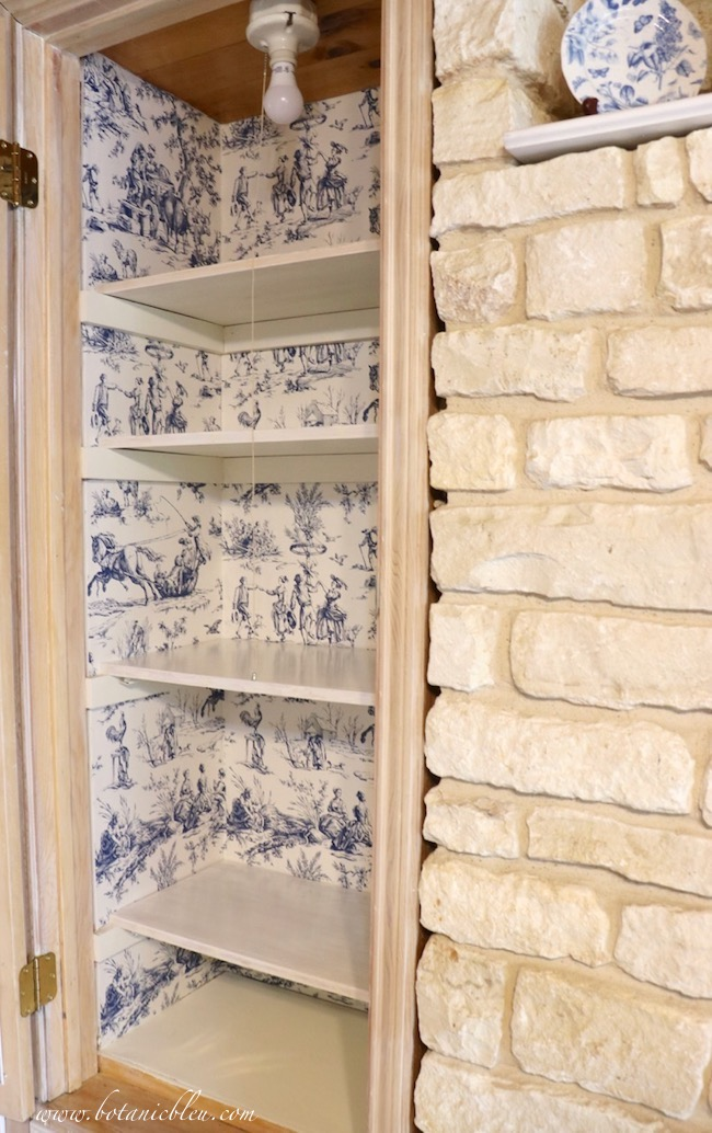 French Country Pantry Makeover with Seasons Toile Wallpaper in blue and white