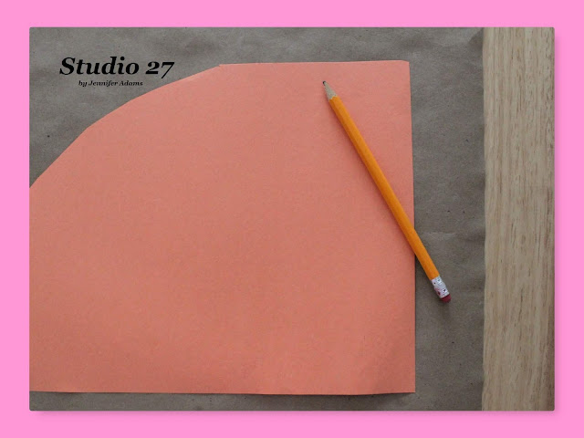 Tracing the construction paper cone template.