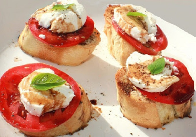 this is whole milk mozzarella with tomato and basil.  this is Italian salad on top of bread called bruschetta which originates from Rome Italy. It has tomato, cheese, basil and drizzled with olive oil and balsamic vinegar. All in a princess house crystal pie plate to catch the drippings.