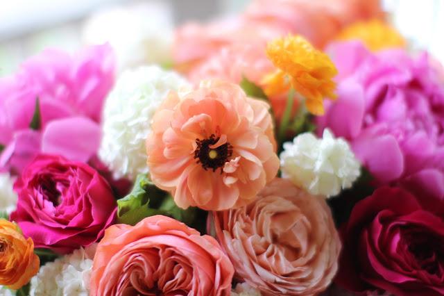 citrus pinks mix ranunculus roses garden roses hydrangea viburnum vines Sweet Pea Floral Design Ann Arbor Wedding florist