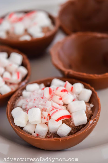 hot chocolate bomb shell filled with cocoa mix, marshmallows and crushed peppermints