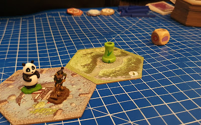 Takenoko family game review gameplay table set up with first 2 hexagons in place