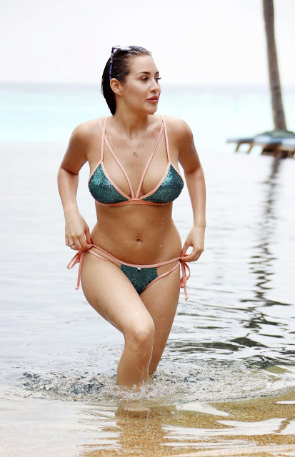 Chloe Goodman in a sequin bikini on the beach in the Maldives