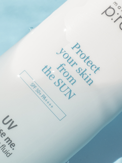 zoomed in photo of a bottle of make p:rem suncream in blue water