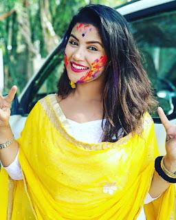 Amrita playing Holi