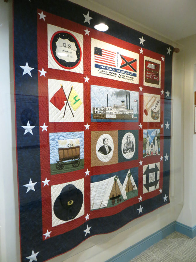 A quilt -red blue and white to honor the national museum of civil war medicine